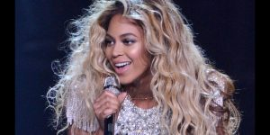 Beyonce singing and smiling