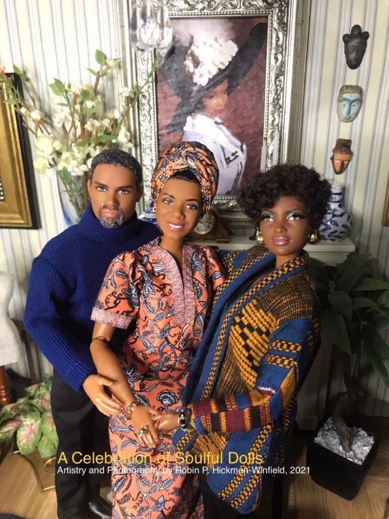 Three Afro American Barbie dolls have an imaginary encounter