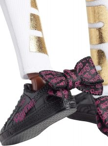 Pink and black Puma sneakers on Barbie
