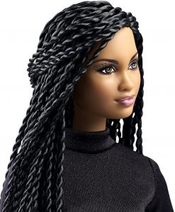close up of light skinned black doll with long braids.