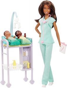 Doll in medical scrubs with two new born babies