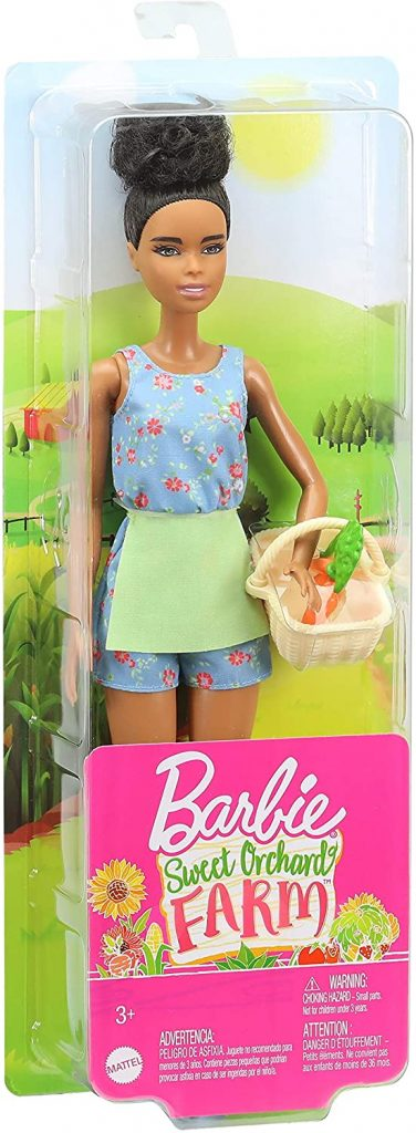 Barbie with afro puff and wicker basket in packaging