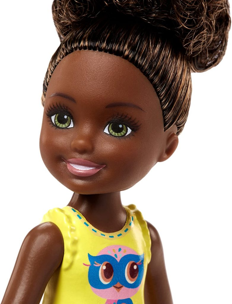 cute black doll with afro puff hairstyle