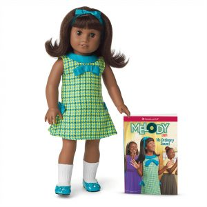 Black doll in 60s dress with book