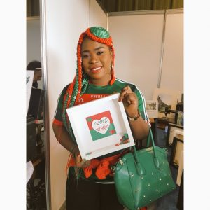 Congolese Irish woman with braids in the Mayo colours