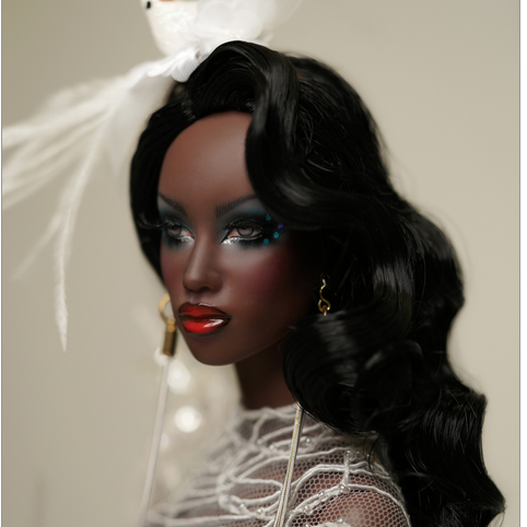 black haired doll with lavish make up and a dove in her hair