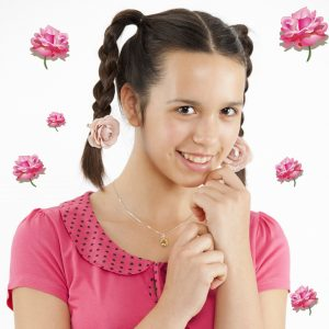 Pretty girl with sweet smile and rose hair clips.