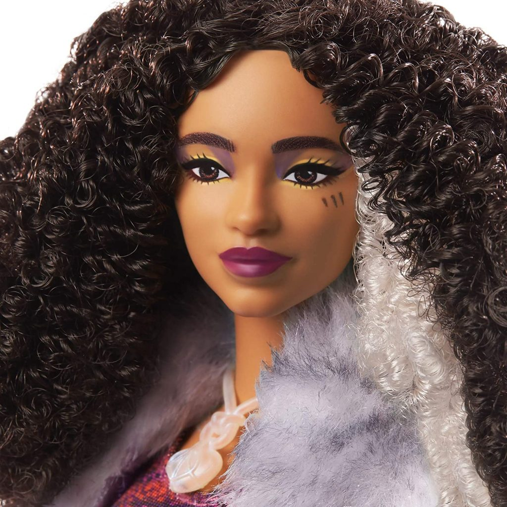 teenage doll with long black curly hair