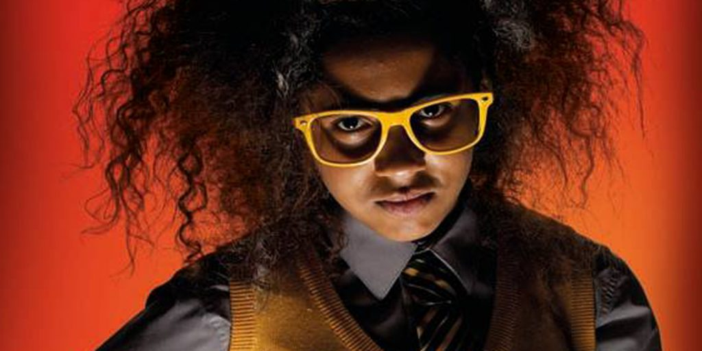 Scowling schoolgirl in yellow glasses with Albert Einstein hair-do