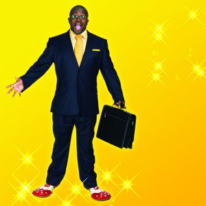 A man in a business suit whose shoes have turned into clown boots.