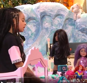 Black girl surrounded by black dolls