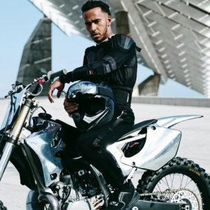 Lewis Halmilton in leathers on a motorbike