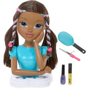 Styling head of black girl with braids and hair accessories