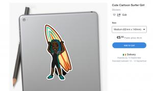 Sticker of a surfer girl stuck to a laptop